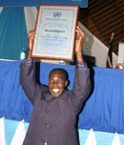"United Nations Award  overal award winning Mirtin King'asia of Kenya Broadcasting coorporation show his UN  award, during  the Un day cerebrations at Kenyatta International Conference centre on October 23 2010. This year's theme is ""Working together for better Kenya"" PHOTO/TOM MARUKO"